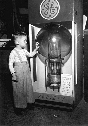 Tommy Dodgen, age 4, standing by the largest lamp in the world : Tampa, Florida, by unknown photogra
