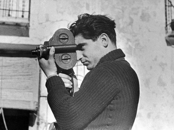 TIME photographer Robert Capa working with movie camera, 1938, LIFE photo archive, Ã'© Time Inc.