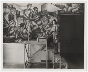 Greenwood standing in front of a mural painted for the WPA Federal Art Project, June 4, 1940. Photog
