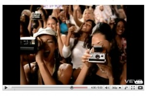 "Still of women with Polaroid cameras from Outkast's ""Hey Ya"" video on YouTube."