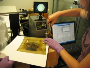 Nora Lockshin, SIA paper conservator, runs a test to determine the chemical make up of the suspect f