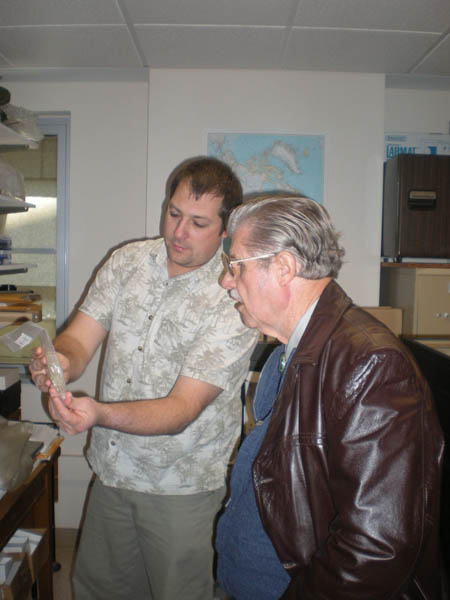 Research Entomologist Dr. Robert Kula (Systematic Entomology Laboratory, USDA) shows capsules for pr