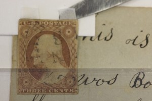 A detail of how a stamp was hinged back in its original location rather than pasted on as in the ori