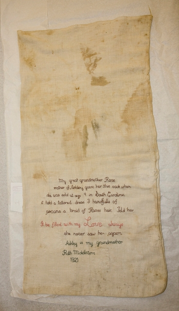 A sack inscribed with family history discovered at a Save Our African American Treasures event held