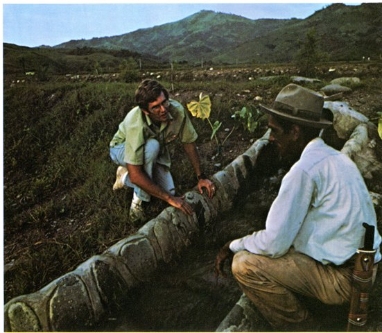 Peace Corps Volunteer discusses new pipeline with farmers in South America, 1973, Smithsonian Instit